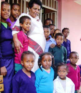 Executive Director of IFSO with sponsored children in Addis Ababa